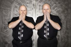 Twin men covering mouth. Stock Photo