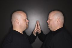 Twin men face to face. Stock Photos