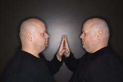 Twin men face to face. stock photos