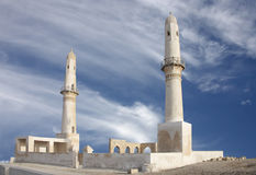 Twin minarets with ruins of Khamis mosque, Bahrain Stock Images