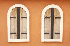Twin old wood and metal windows Royalty Free Stock Photo
