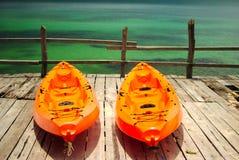 Twin orange canoe Royalty Free Stock Images