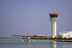 Twin Otter Seaplane and control tower Royalty Free Stock Image