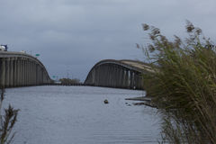 Twin Overpasses. Two overpasses over water with diminishing perspective Royalty Free Stock Photo