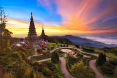 Twin pagoda in doi Inthanon national park with sunrise and morning mist at Chiang mai. Thailand royalty free stock photos
