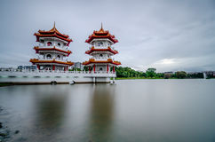 Twin Pagoda. Gloomy View of Chinese Garden`s Twin Pagoda Royalty Free Stock Photos