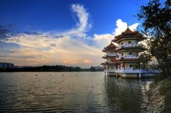 Twin Pagoda by the Lake. A fine example of classical Chinese architecture, this pagoda sits nicely by the edge of a lake. Photo taken at the Chinese Garden in Stock Image
