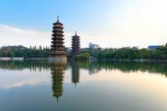Twin pagodas in banyan lake Stock Photos