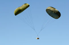 Twin parachute box drop Royalty Free Stock Photography