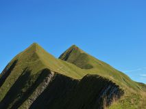 Twin peaks. Of a mountain-chain, mountain called Tannhorn Royalty Free Stock Photography