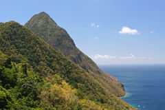 Twin peaks in the caribbean. Twin mountain peaks called the Pitons in St. Lucia Caribbean Stock Photos