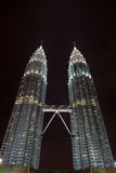 Twin Petronas Towers Sparkle in Night Sky Stock Photo