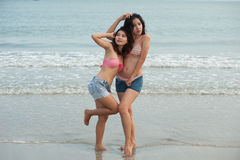 Twin pretty Thai woman  posing on the beach . Royalty Free Stock Images