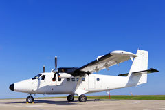 Twin propeller airplane on a runway. Royalty Free Stock Image