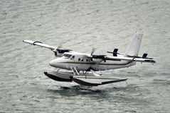 Twin propeller engine hydroplan taking off Stock Images