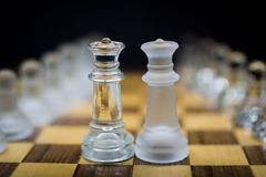 Twin Queens, Icy Queen chess pieces on a black background royalty free stock photo