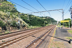 Twin Rail Tracks Leading Through Rural Railway Station Royalty Free Stock Photo