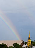 Twin rainbow in rainy day in the evening. Rainbow above a thai temple in rainy day in the evening Stock Image