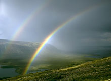 Twin rainbows Royalty Free Stock Photo