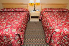 Twin red beds in room Stock Photo