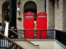 The twin red telephone box. Twin red telephone box outdoor building interior royalty free stock photography