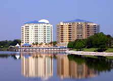 Twin resort buildings reflected in lake. One under construction Royalty Free Stock Photos