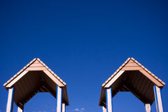 Twin roofs. Two tops of a playground structure Stock Photos