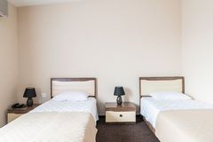 The twin room in modern hotel Royalty Free Stock Photos