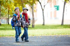 Twin schoolkids Stock Images