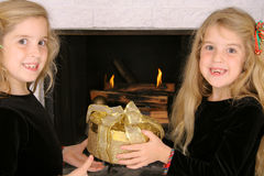 Twin sister gift exchange Stock Image