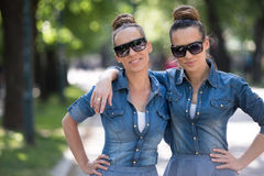 Twin sister with sunglasses Royalty Free Stock Photography