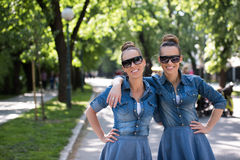 Twin sister with sunglasses Royalty Free Stock Images