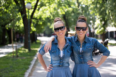 Twin sister with sunglasses Stock Images