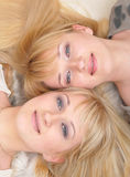 Twin sisters. Looking at camera with smiles Stock Images