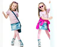 Twin sisters behind a white board Royalty Free Stock Images