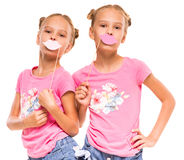 Twin sisters. Cheerful twins girls are ready to the party with paper handmade Royalty Free Stock Image