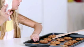 Twin sisters cleaning up after baking. Cookies at home in kitchen stock video footage