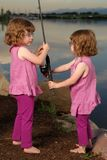 Twin Sisters Fishing Royalty Free Stock Photo