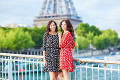 Twin sisters in front of the Eiffel tower in Paris, France Royalty Free Stock Images