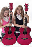 Twin sisters with guitars. Isolated on white Stock Photography