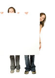Twin sisters holding a white banner Stock Image
