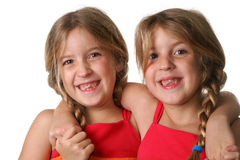 Twin sisters hugging Stock Photography