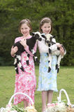 Twin Sisters With Lamb on Easter Stock Photography