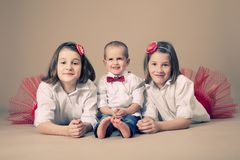 Twin sisters with little brother Royalty Free Stock Photo