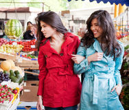 Twin sisters market Stock Photos