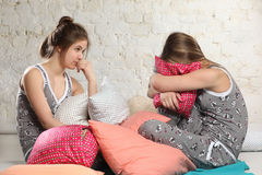 Twin sisters with pillows in the bedroom Stock Photo