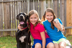 Twin Sisters Puppy Pet Dog And Great Dane Playing