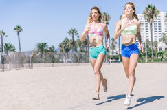 Twin sisters running in the morning in Los angeles Royalty Free Stock Images