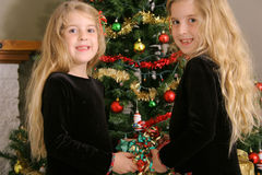 Twin sisters sharing a present Royalty Free Stock Photography