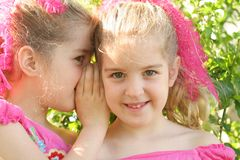 Twin sisters sharing a secret Stock Images